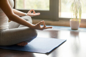 Yoga at home: meditating close-up